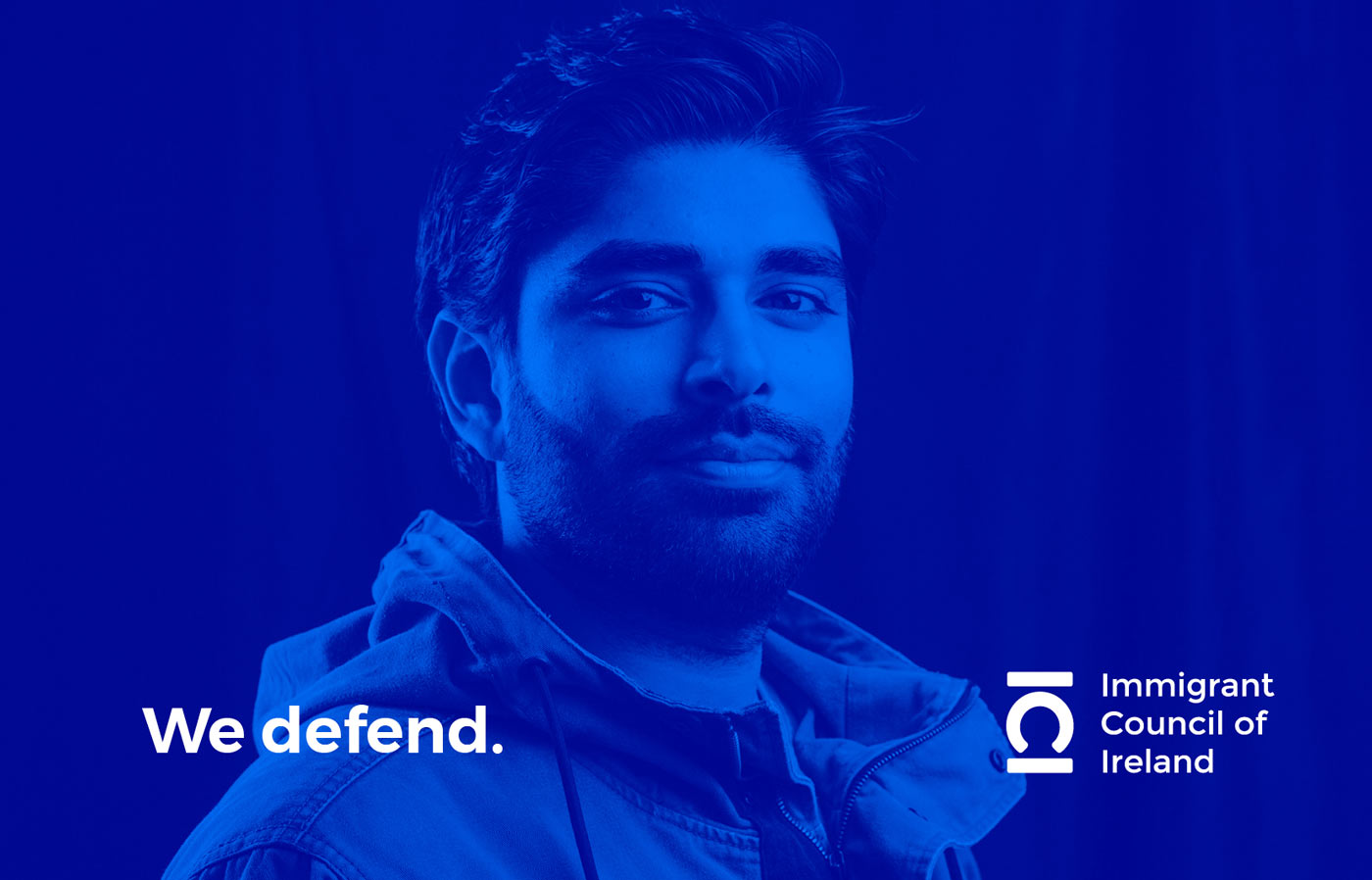 Immigrant Council of Ireland photography production, brand development, and logo design with image of young man in shades of blue.
