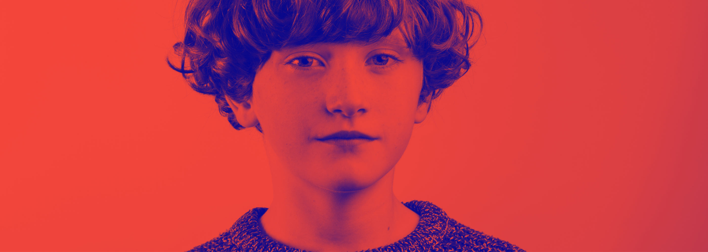 Immigrant Council of Ireland brand development featuring photo of young boy in red and blue