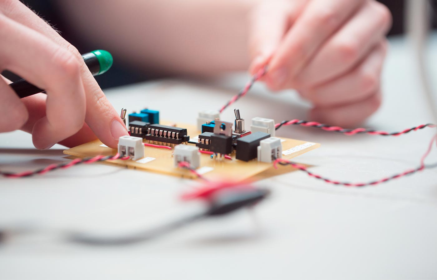 LIT Electrical and Electronic Engineering photography. Close-up of student working on electronics.