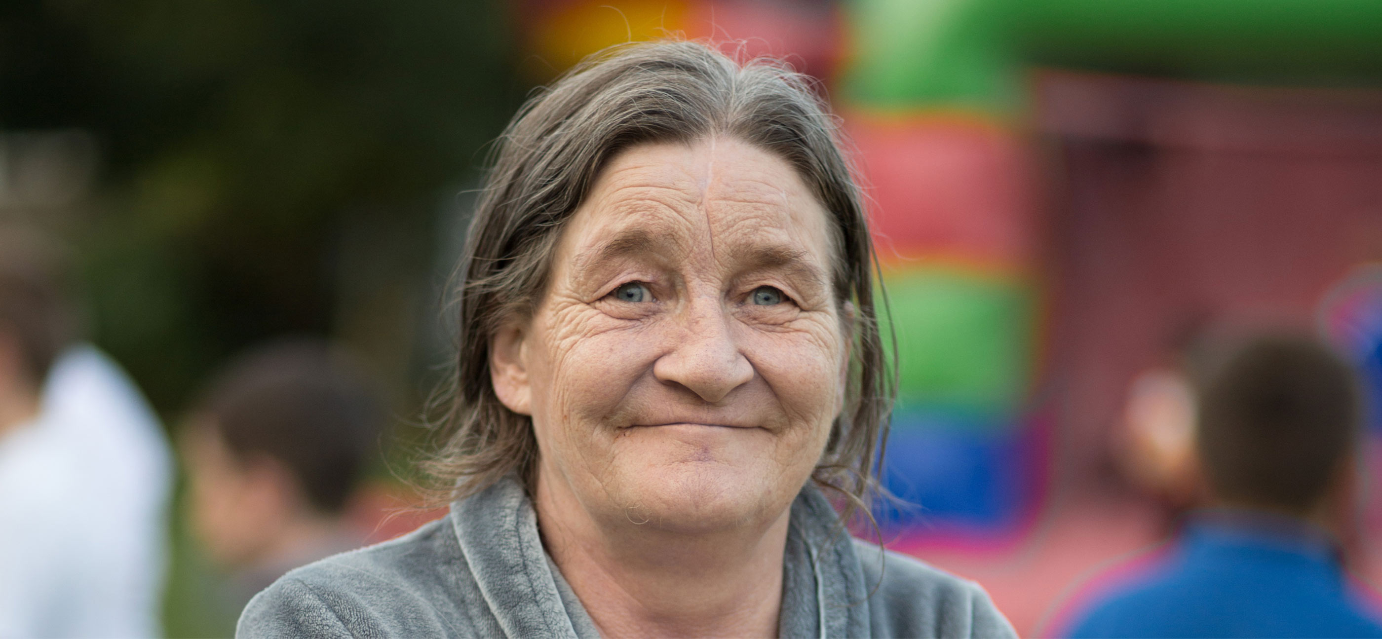 Novas content creation. Photograph of smiling middle-aged woman.