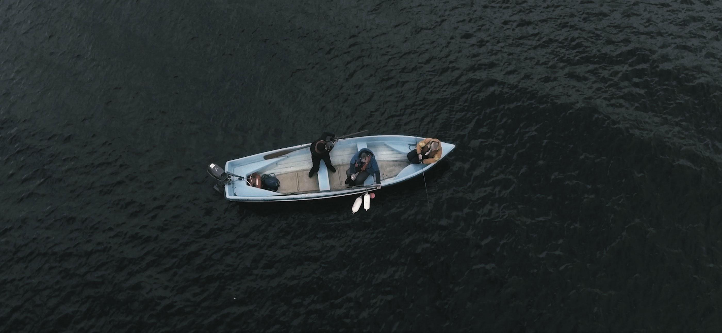 Novas video & photography production. Joe & Joe Go Fishing. Three men in a boat.