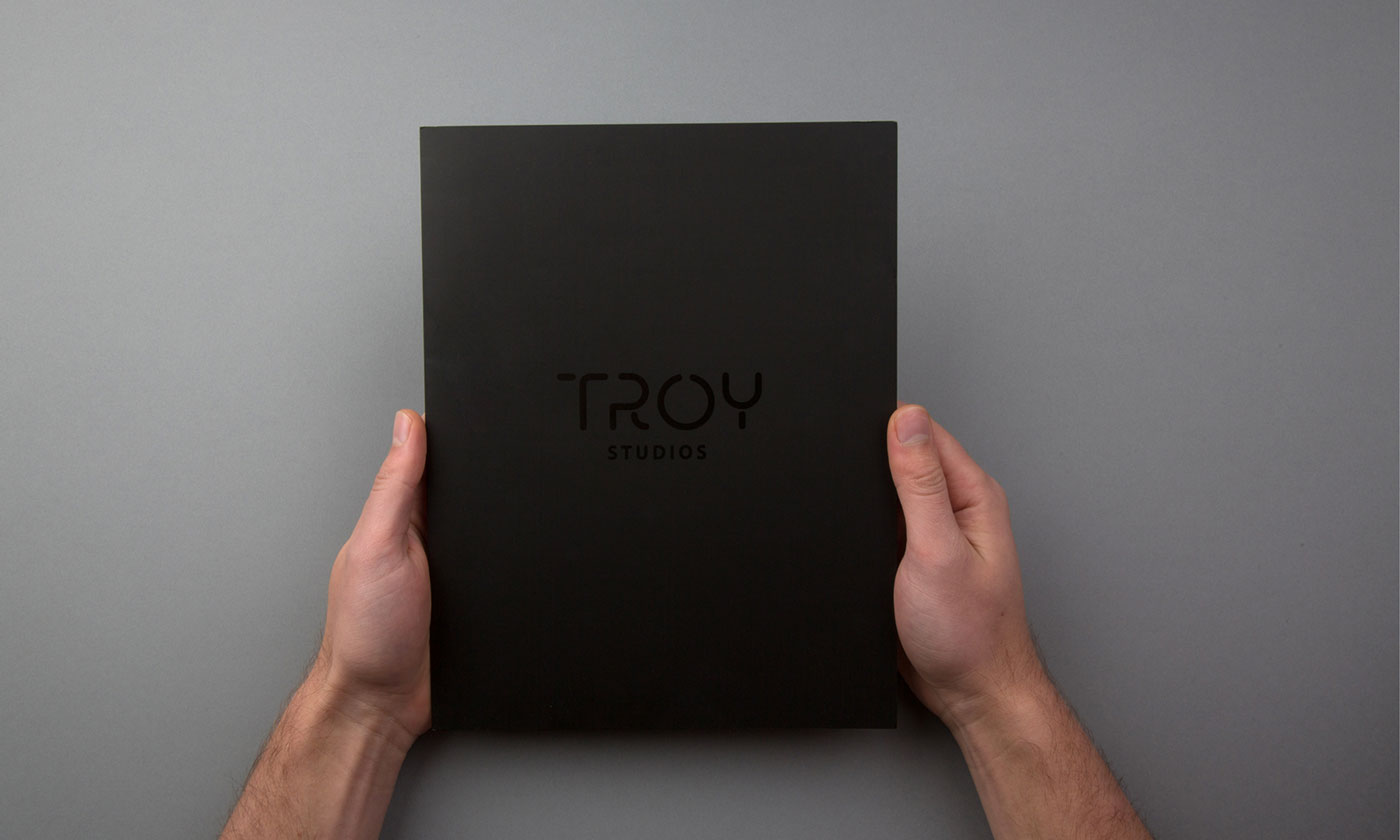 Troy Studios Limerick brochure graphic design. Front cover held by pair of hands.
