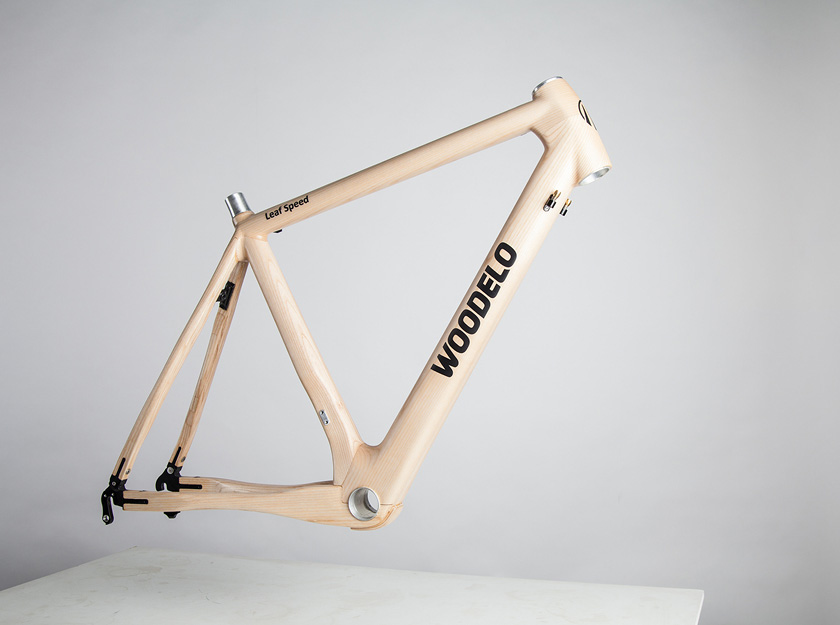 Woodelo product photography floating wooden bicycle frame
