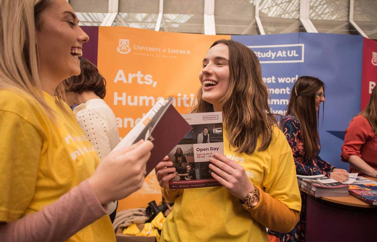 UL Undergrad brand identity on tshirts, banners and brochures. Image features two student volunteers and others in the background